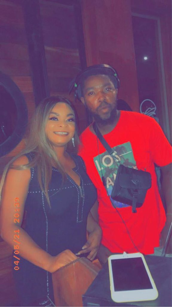 Beverly Afaglo sprays money on Radical DJ at an event