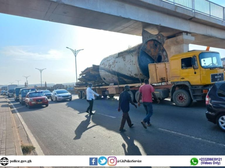 Tema bound loaded lowbed trailer stuck under bridge in Accra, leading to traffic delays
